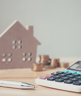 Image of a House and Calculator for Mortgage Loans